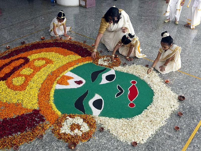 Teacher and students at RBK Global school in Bhayander prepare rangoli for Onam celebrations, in Mumbai. (Pratham Gokhale/HT photo)