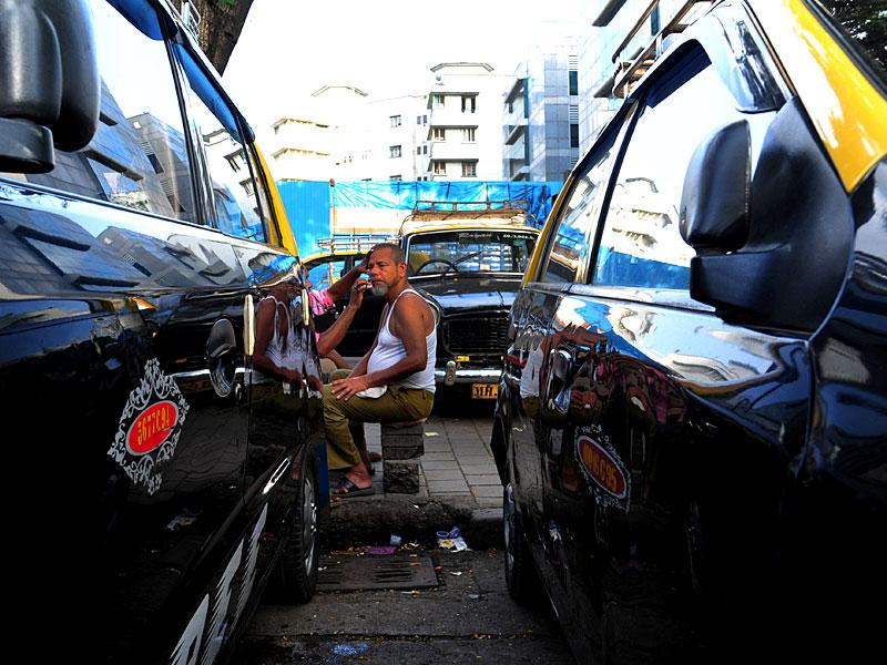 Taxi driver rests on the day when the taxi unions had called a day-long strike, in Mumbai. (Anshuman Poyrekar/HT photo)