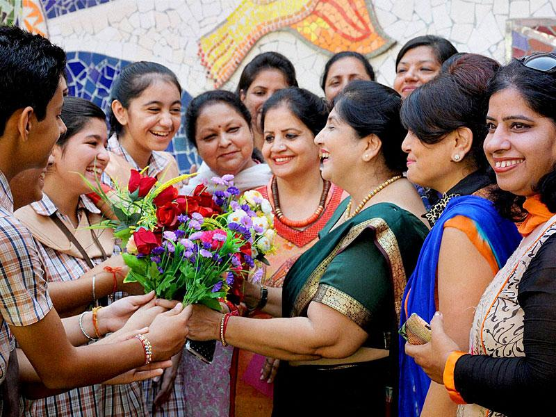 Students greet their teachers on the eve of Teacher's Day at a school in Amritsar on Friday. (PTI photo)