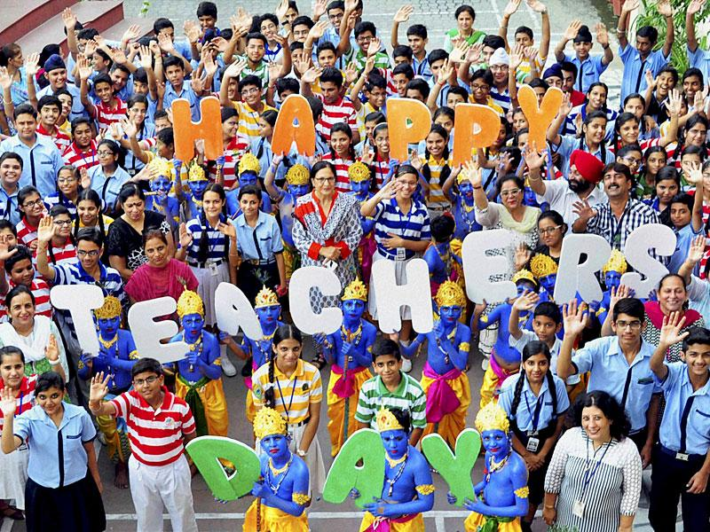 Students and teachers celebrating Teacher's Day and Janmashtami at a school in Ambala Cantt on Friday. (PTI photo)