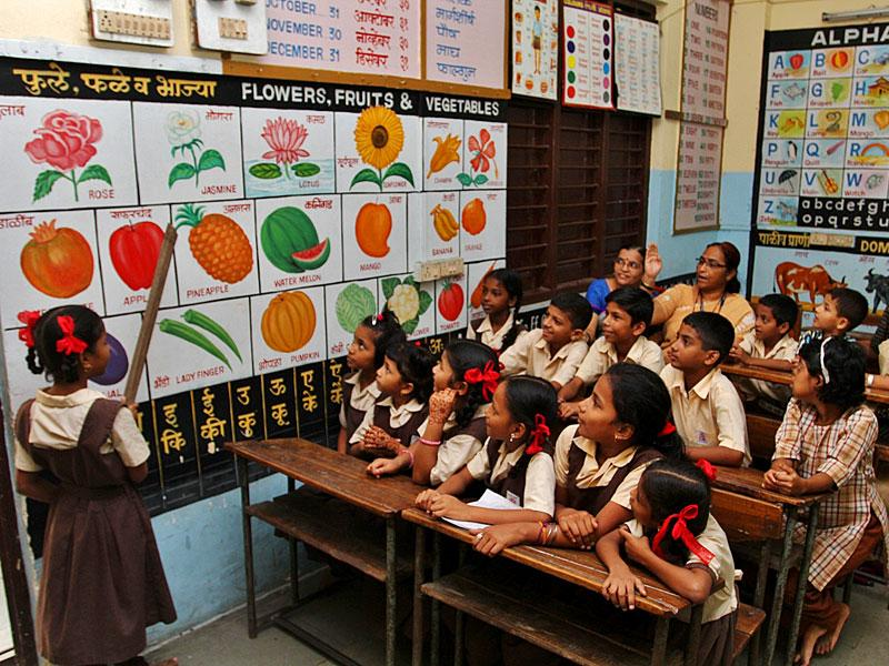 A young student takes up the job of a teacher as part of Teacher's Day celebration, in Mumbai. (HT photo)