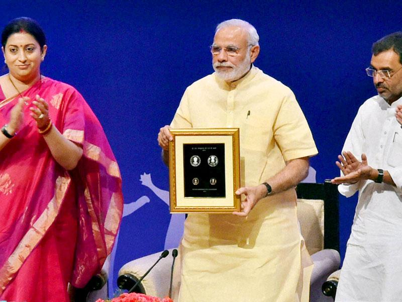 Prime Minister Narendra Modi releasing commemorative coins of rupees 125 and rupees 10 to mark the 125th birth anniversary of Dr Sarvepalli Radhakrishnan on the eve of Teacher's Day at Manekshaw Centre in New Delhi on Friday.