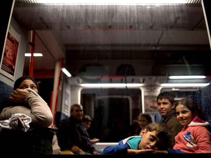 Migrants rest on a train to Vienna as they leave from Nickelsdorf. Thousands of migrants streamed into Austria on Saturday, desperate to travel on to Germany after days of ugly standoffs with authorities in Budapest's train station that made headlines worldwide. (AFP Photo)