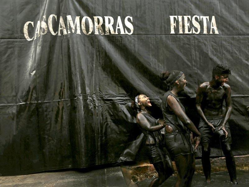 Revellers covered in grease take part in the annual Cascamorras festival in Baza, southern Spain. (Reuters Photo)