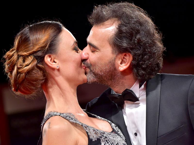 Argentinian director Pablo Trapero and Martina Gusman kiss as they arrive for the screening of the movie El Clan (The Clan) presented in competition at the 72nd Venice International Film Festival on September 6, 2015 at Venice Lido. (AFP)