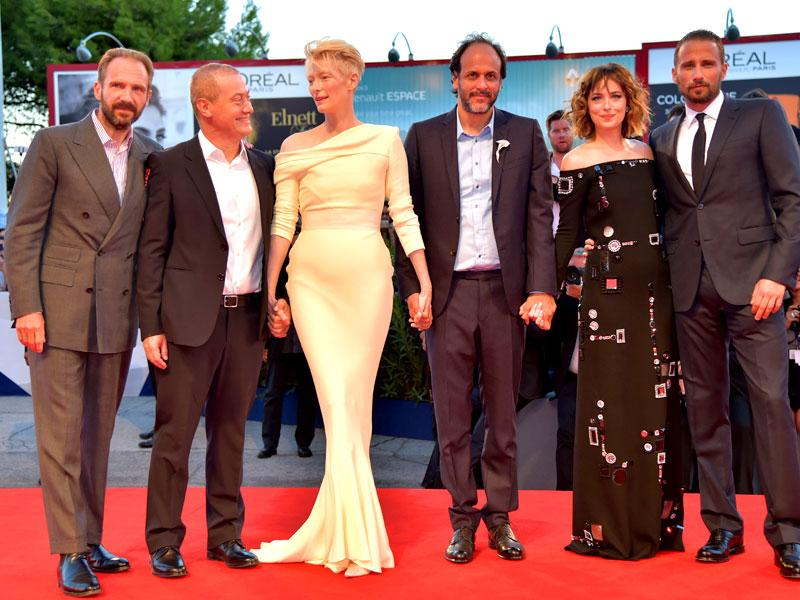 (From left) Actors Ralph Fiennes and Corrado Guzzanti, actor Tilda Swinton, director Luca Guadagnino, actor Dakota Johnson and actor Matthias Schoenaerts arrive for the screening of the movie A Bigger Splash presented in competition at the 72nd Venice International Film Festival on September 6, 2015 at Venice Lido. (AFP)