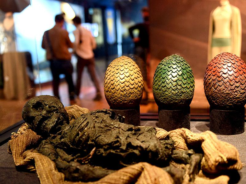 Prop items, such as dragon eggs, are pictured during the opening of an exhibition dedicated to HBO's television medieval fantasy series Game of Thrones at the Carrousel du Louvre in Paris. (AFP Photo)
