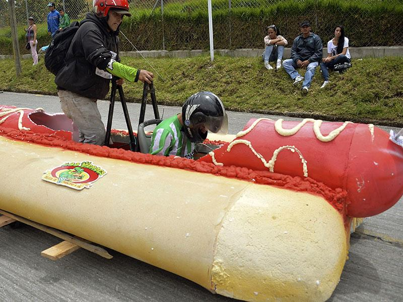 Participants in a homemade hot-dog-shaped car during the XXVI Car Festival in Colombia on September 6, 2015. (AFP)