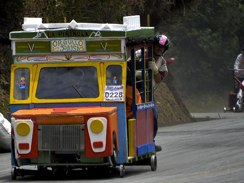 Participants descend a hill in a homemade bus-shaped car on September 6, 2015. (AFP)
