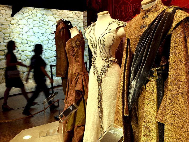 The costumes of Queen Cersei, Margery Tyrell and King Joffrey Baratheon from the Purple Wedding in Season 4. (AFP Photo)