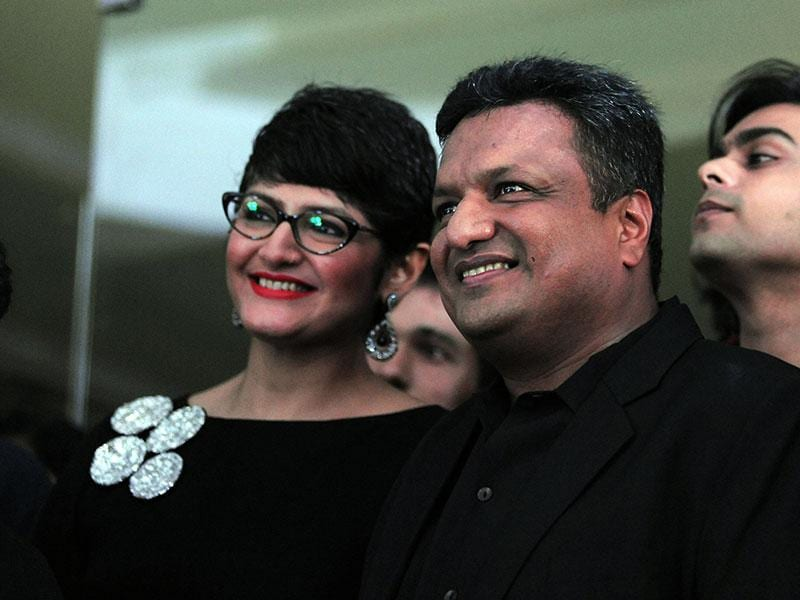 Filmmaker Sanjay Gupta poses with his wife during the song launch of Jazbaa. (AFP Photo)