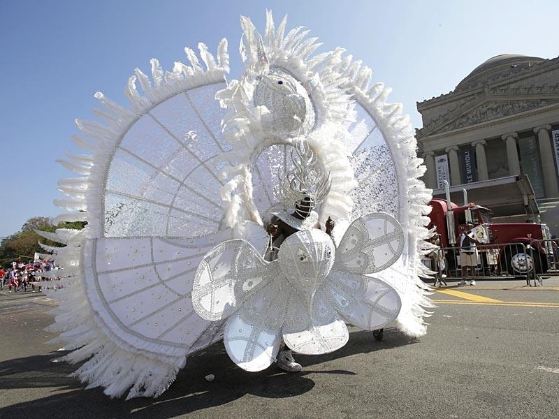 A dancer with D'Midas International Boston marches in the West Indian Day Parade past the Brooklyn Museum September 7, 2015. (AP)