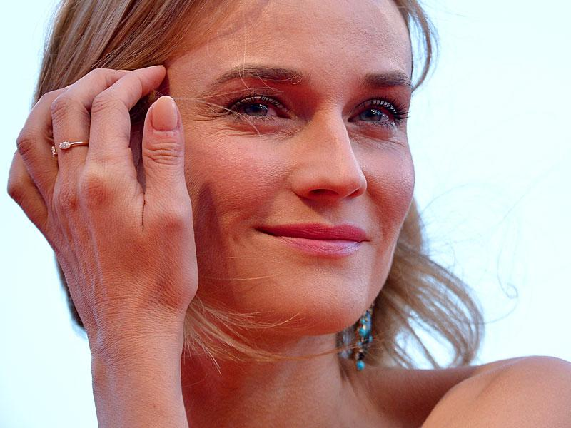 Diane Kruger poses at the red carpet for the screening of 11 Minutes at the Venice Film Festival. (AFP)