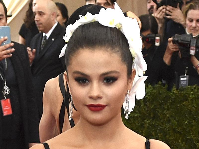Selena Gomez often plays the cute card but she went all-out seductive for this year's MET Gala, pulling together a racy look based around a deep burgundy lip.