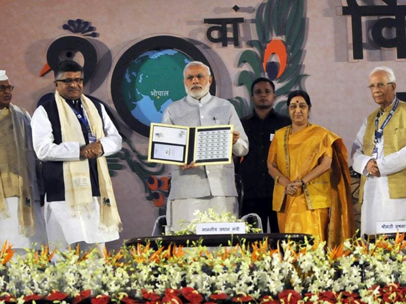 Prime Minister Narendra Modi releasing special stamp to commemorate 10th World Hindi conference, in Bhopal on Thursday. (Praveen Bajpai/HT)