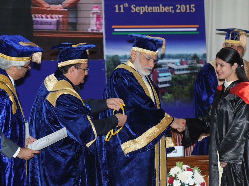 PM Narendra Modi congratulating a doctor during the convocation ceremony of the Post Graduate Institute of Medical Education and Research in Chandigarh on Friday (Keshav Singh/HT)