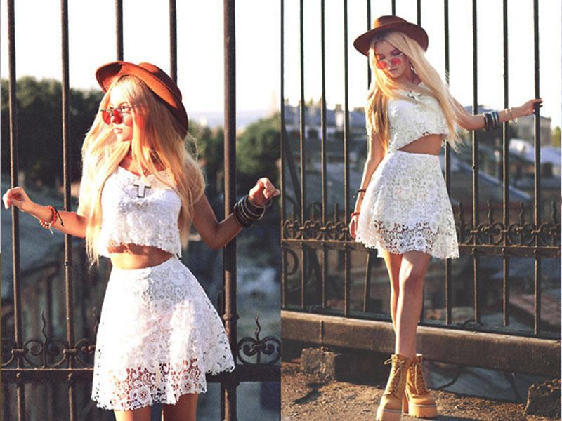 Craving a change from summer's staple dresses? Take a break with a stylish white crop top-short skirt number.