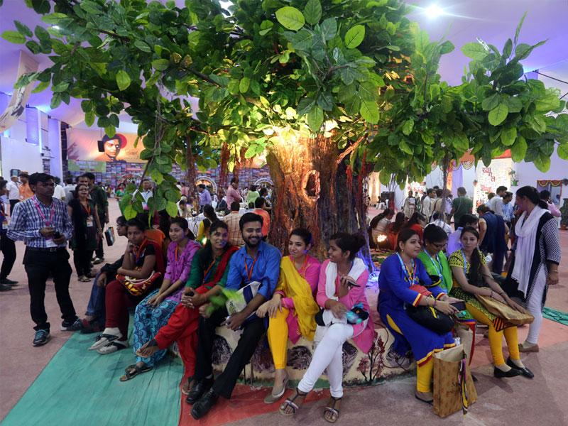 Participants sitting under the replica of Bodhi Tree at the venue of 10th World Hindi Conference in Bhopal. (Praveen Bajpai/HT photo)
