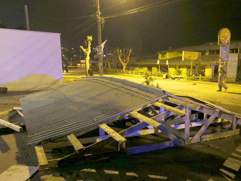 The roof of a shop is pictured on the ground after it was dislodged by waves in Concon city. (Reuters)