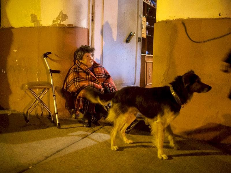 A resident stays outside her house after an earthquake hit Chile's central zone, in Santiago, Chile. (Reuters)
