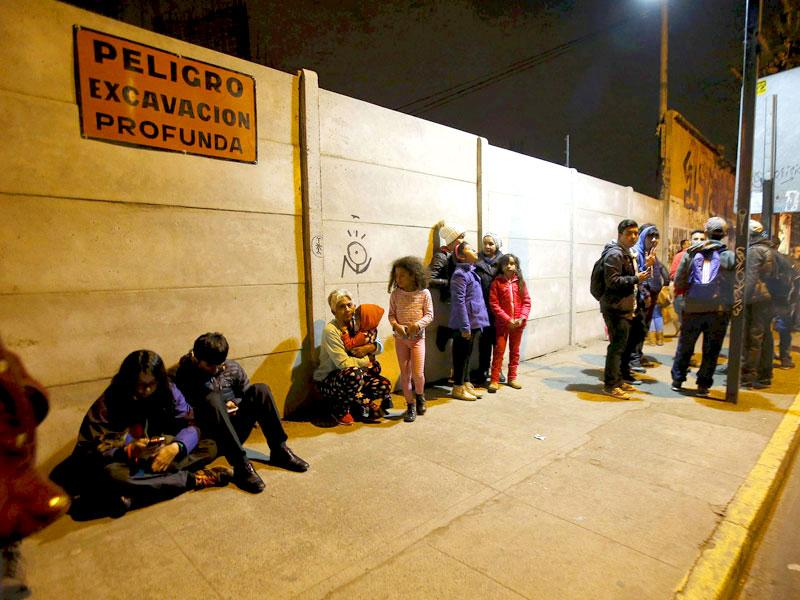 Residents stay on the street outside their houses after an earthquake hit Chile's central zone, in Santiago, Chile. (Reuters)