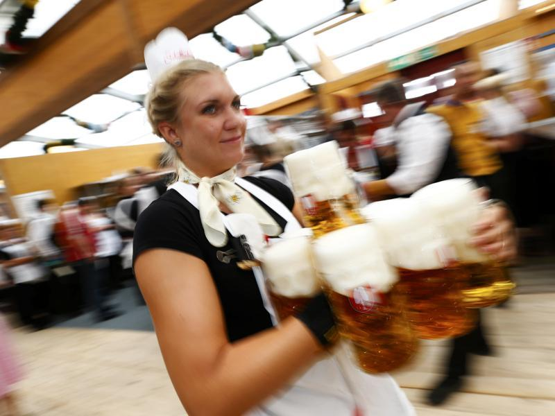 A waitress carries beer in a tent during the 182nd Oktoberfest in Munich.  (REUTERS)