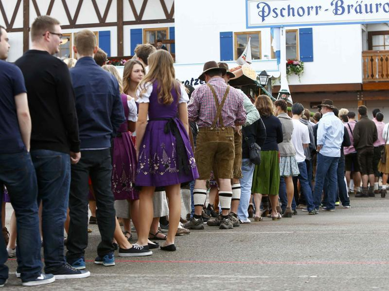 The long wait: Visitors stand in a queue ahead of the opening of the Oktoberfest on Saturday. (REUTERS)