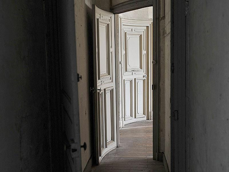 Seen in this photo is a corridor where footsteps and banging of doors have been heard in the castle of Fougeret. (AFP Photo)