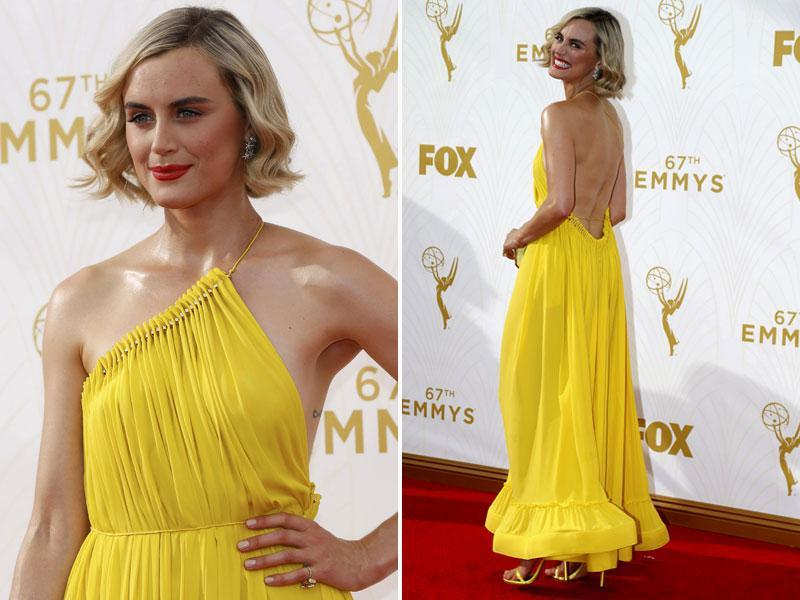 Orange is the New Black star Taylor Schilling brought a dash of colour to the red carpet with her bright yellow dress. (AGENcies)