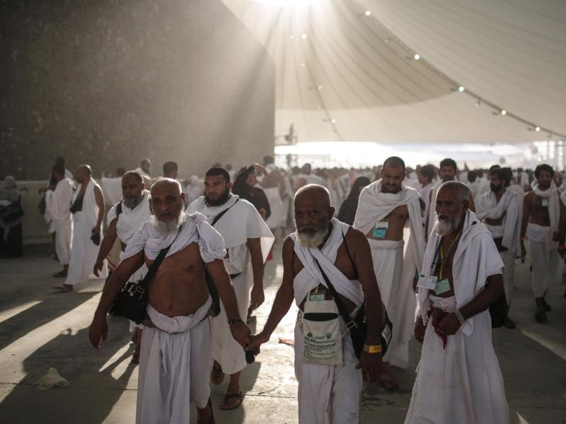"Muslim pilgrims during a ritual ""Jamarat"" - the last rite of the annual haj - in which they cast stones at a pillar to symbolize the stoning of Satan, on the first day of Eid al-Adha, in Mina near Mecca, Saudi Arabia. (AP)"