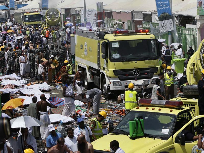 Saudi emergency services move among the bodies of those killed in the stampede in the Mina neighbourhood of Mecca. These pilgrims were on a pilgrimage to observe one of the stages of haj. (EPA)