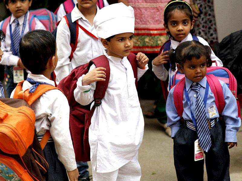 Students wear full sleeves as a precaution against dengue at a school in New Delhi. (Arun Sharma/ HT Photo)