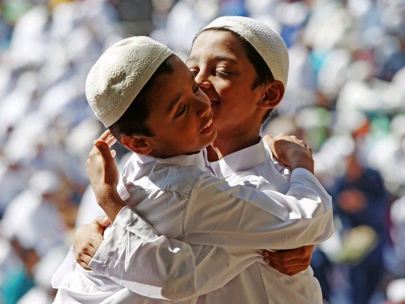 Indian Muslims boys hug each other after their morning prayers on the occasion of Eid al-Adha in Bangalore, India. (ePA)