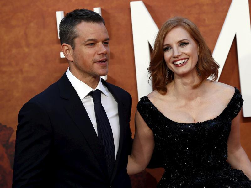 Actors Matt Damon and Jessica Chastain arrive for the UK premiere of The Martian at Leicester Square in London. (REUTERS)