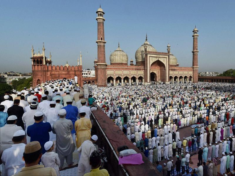 Muslims offer prayers to mark the festival of Eid al-Adha at Jama Masjid in New Delhi on Friday. (PTI)