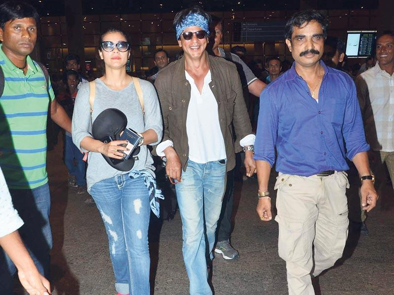 Shah Rukh Khan and Kajol, who were returning after completing a shooting schedule in Bulgaria, were seen at the Mumbai airport. Before exiting the airport in his own vehicle, SRK went all the way to Kajol's car to see her off. (Photo: Viral Bhayani)