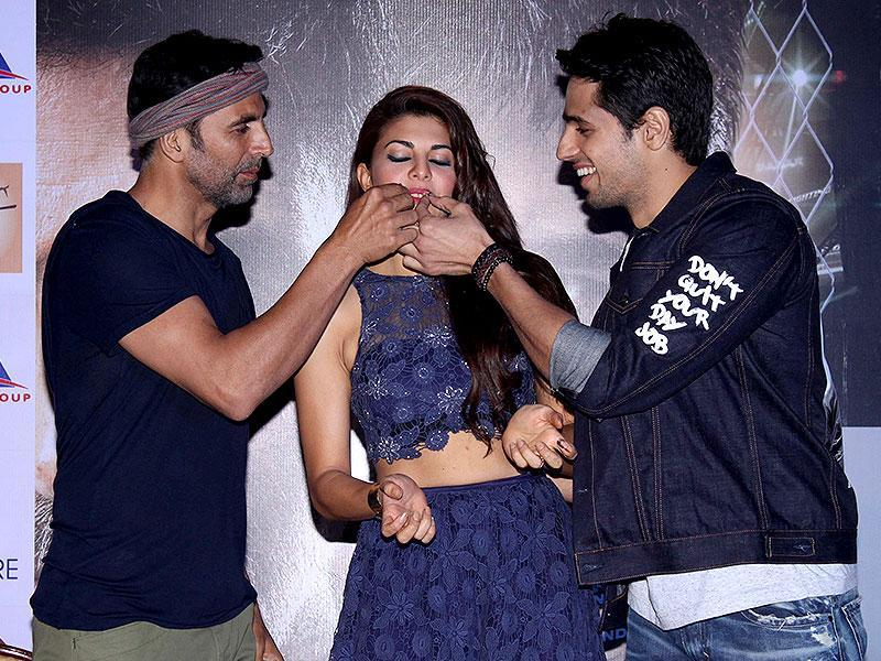 Sidharth Malhotra and Akshay Kumar celebrate Jacqueline Fernandez's birthday during a press conference regarding their upcoming film Brothers in New Delhi, on Aug 11, 2015. (Photo: IANS)