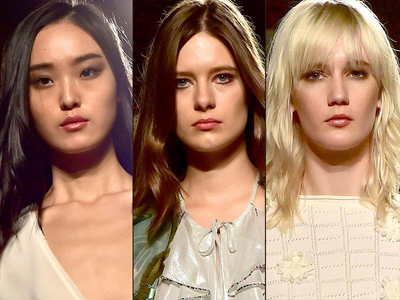 Models at Kristina Ti smoldered, thanks to a smoky eye and wine red lip combination and their dewy complexions and filled-in brows. (AFP)