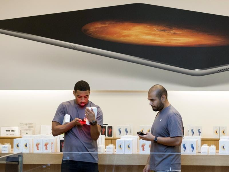 Apple store employees work with boxes of phones as the Apple iPhone 6S and 6S Plus go on sale at an Apple Store in Los Angeles. (Reuters Photo)