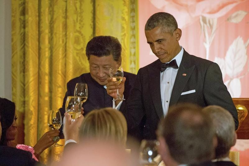 Chinese President Xi Jinping and President Barack Obama toast with first lady Michelle Obama during a State Dinner, in the East Room of the White House in Washington.  (AP Photo)