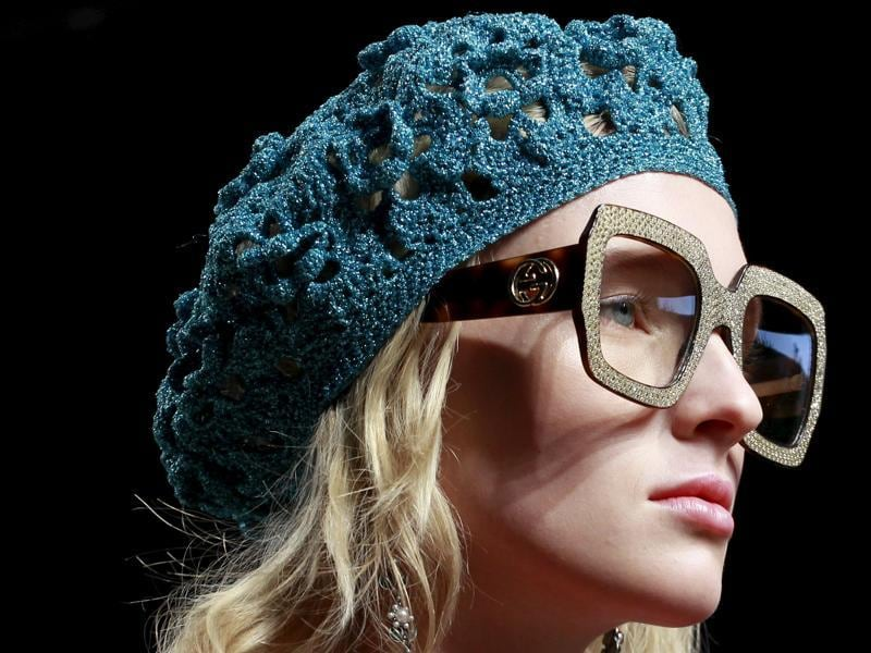 Tortoise-shell glasses and voluminous blow-outs brought 'geek chic' back into focus at Gucci. (REUTERS)