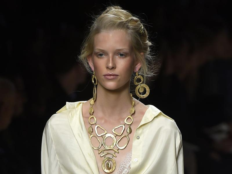 An elaborate up-do softened by strands of hair falling around the face invoked the desert at Alberta Ferretti, supported by sandy-toned bronzer and a dusky pink lip. (AFP)