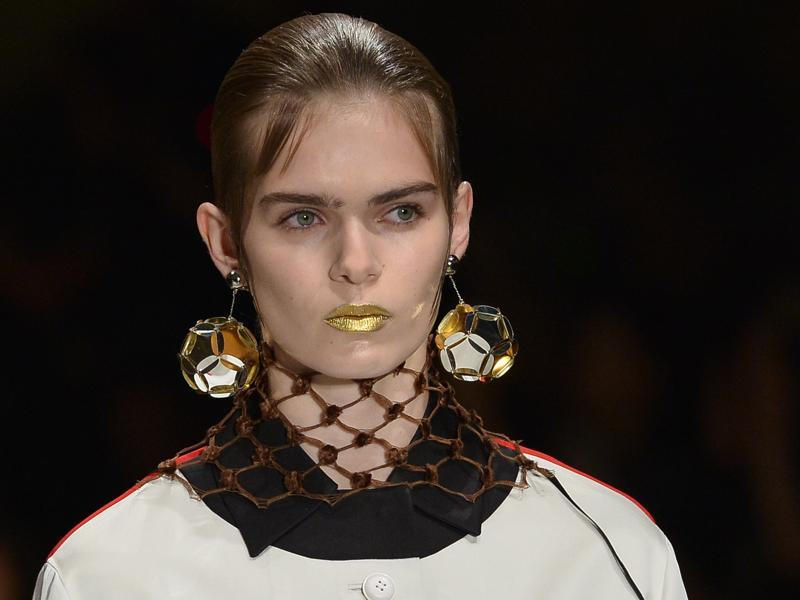 Prada had fun experimenting with an opaque gold lip and a hairstyle that looked a lot like sideburns. (AFP)