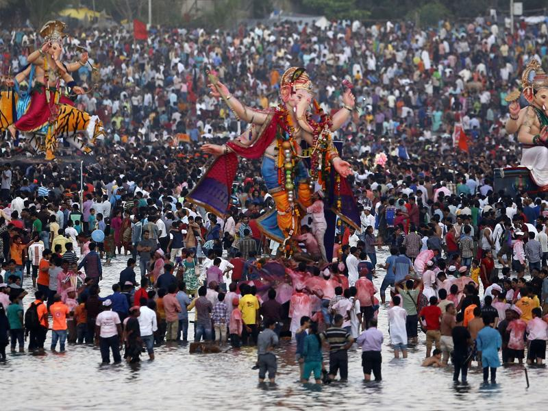 Devotees prepare to immerse idols of Lord Ganesha in the Arabian Sea in Mumbai. (AP Photo)