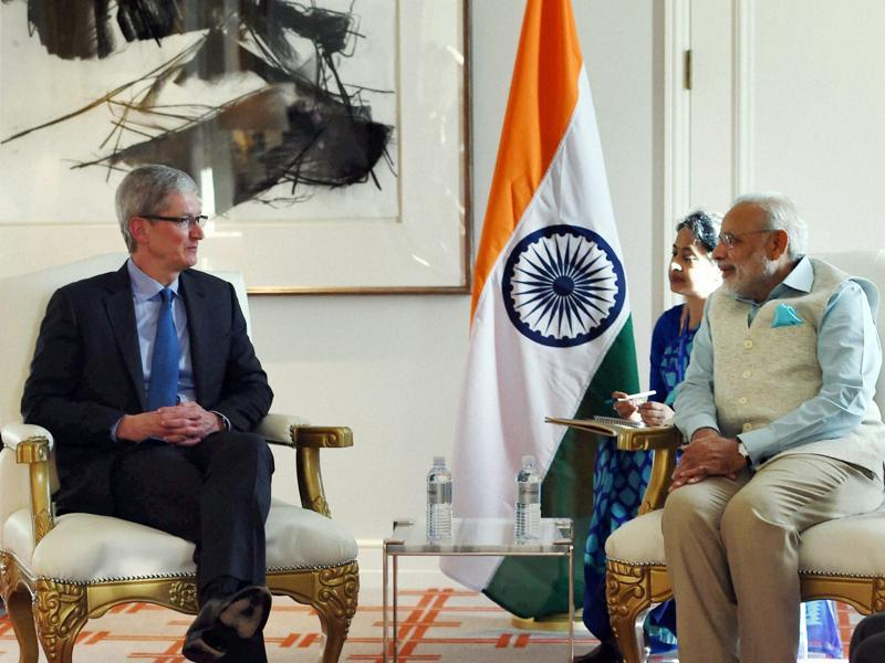 Prime Minister Narendra Modi with Tim Cook, CEO Apple Inc. at a meeting in San Jose on Saturday. (PTI Photo)
