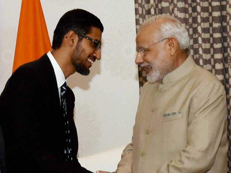 Prime Minister Narendra Modi shakes hands with Google CEO Sundar Pichai at a meeting in San Jose on Saturday.  (PTI Photo)