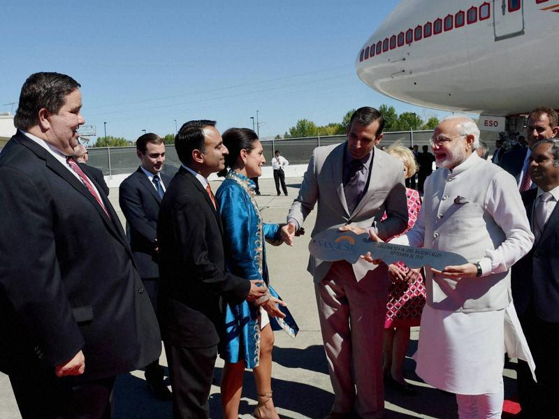 Prime Minister Narendra Modi is welcomed with a city key on his arrival at Norman Y. Mineta San José International Airport on Saturday. (PTI Photo)