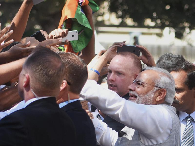 Prime Minister Narendra Modi is welcomed by Indian community people on his arrival at Norman Y. Mineta San José International Airport on Saturday. (PTI Photo)