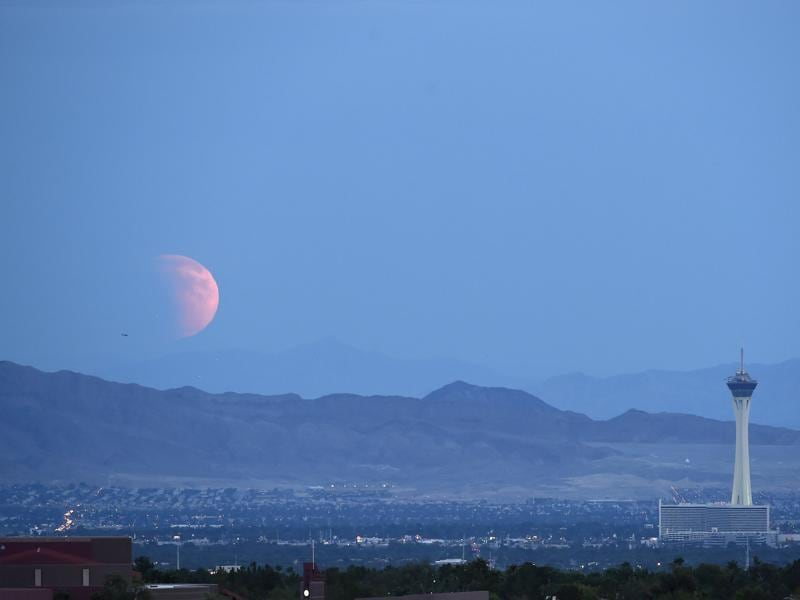 A partially eclipsed supermoon, the last of this year's supermoons, rises over Las Vegas, Nevada, September 27, 2015.  The total supermoon eclipse, known as a 'blood moon', is an incredibly rare celestial event. (REUTERS Photo)