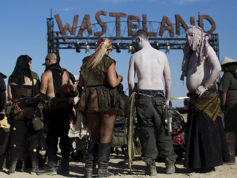 Enthusiasts wearing costumes are pictured during the Wasteland Weekend event in California City, California September 26, 2015. The four-day event has a post-apocalyptic theme and is inspired by the Mad Max movie franchise.  (REUTERS)